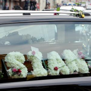 A hearse carrying the coffin of Sian O'Callaghan makes its way along Newport Street in Swindon