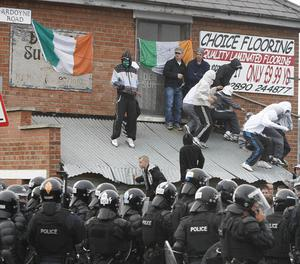 Police and nationalist protesters after an Orange Order march in north Belfast
