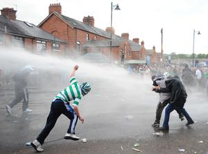Police have fired a number of baton rounds after being attacked with petrol bombs by rioters in north Belfast