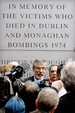 Sinn Fein President Gerry Adams speaks to the media in front of the Dublin Monaghan Bombings memorial in Dublin city centre, in response to the royal visit by Queen Elizabeth