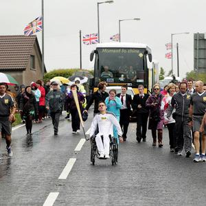 Paul McLister carried the Olympic Flame on the Torch Relay leg between Ballymena and Moorfields before it was taken via ferry to Scotland