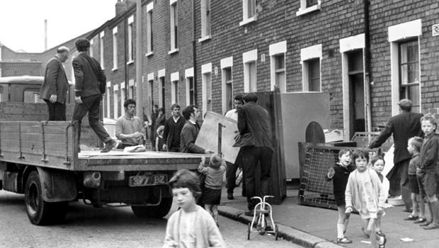 A family flee their home during rioting in Belfast 1969