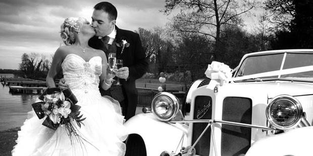 """Michelle McLouglin and Brian McMullan share a kiss on their wedding day <p><b>To send us your Wedding Pics <a  href=""""http://www.belfasttelegraph.co.uk/usersubmission/the-belfast-telegraph-wants-to-hear-from-you-13927437.html"""" title=""""Click here to send your pics to Belfast Telegraph"""">Click here</a> </a></p></b><p>We will publish them online and in the belfast Telegraph</p>"""