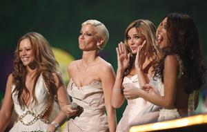 British band Girls Aloud react after collecting the Best British Single Award  at the Brit Awards 2009 at Earls Court