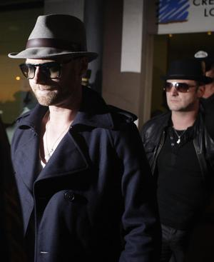 Members of the Irish boy band Boyzone, Ronan Keating, left, and Mikey Graham, right, arrive with other members of the group at the Palma de Mallorca airport on Sunday Oct. 11, 2009.