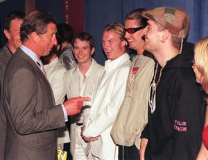 5/7/1998 of The Prince of Wales talking with members of the band Boyzone Party in the Park, in aid of the Prince's Trust.