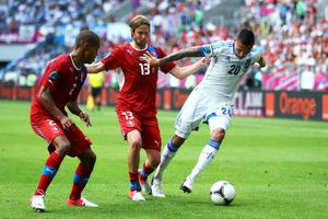 WROCLAW, POLAND - JUNE 12:  Jose Holebas of Greece and Jaroslav Plasil  of Czech Republic compete for the ball during the UEFA EURO 2012 group A match between Greece and Czech Republic at The Municipal Stadium on June 12, 2012 in Wroclaw, Poland  (Photo by Clive Mason/Getty Images)