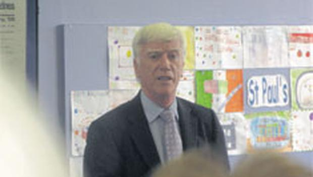 Liam Parker, former assistant chief librarian, recounts the history of the Falls Road Library