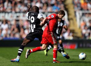 NEWCASTLE UPON TYNE, ENGLAND - APRIL 01:  Jon Flanagan of Liverpool is challenged by Demba Ba of Newcastle United during the Barclays Premier League match between Newcastle United and Liverpool at Sports Direct Arena on April 1, 2012 in Newcastle upon Tyne, England.  (Photo by Alex Livesey/Getty Images)