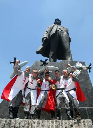 Members of the MIGS (Men In George Suits) supporters club stand in front of the statue of Lenin in Donetsk, Ukraine