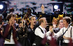Robbie Williams and Take That's Gary Barlow join stars on stage for a special performance at the BBC Children in Need Rocks concert