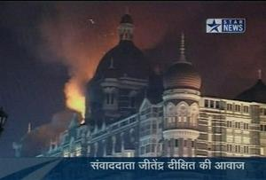 Flames and smoke erupt from the Taj Mahal hotel in Mumbai, India in this image made from television, Wednesday, Nov. 26, 2008. Teams of heavily armed gunmen stormed luxury hotels, a popular restaurant and a crowded train station in coordinated attacks across India's financial capital Wednesday night, killing at least 78 people and taking Westerners hostage, police said. A previously unknown group, apparently Muslim militants, took responsibility for the attacks. A raging fire and explosions struck one of the hotels, the landmark Taj Mahal, early Thursday.  (AP Photo/STAR NEWS)  **  INDIA OUT  TV OUT  **