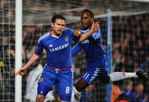 LONDON, ENGLAND - MARCH 01:  Frank Lampard of Chelsea celebrates scoring his penalty with Didier Drogba during the Barclays Premier League match between Chelsea and Manchester United at Stamford Bridge on March 1, 2011 in London, England.  (Photo by Clive Mason/Getty Images)