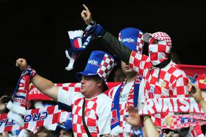 POZNAN, POLAND - JUNE 14:  Football fans enjoy the pre-match atmopshere during the UEFA EURO 2012 group C match between Italy and Croatia at The Municipal Stadium on June 14, 2012 in Poznan, Poland.  (Photo by Jamie McDonald/Getty Images)