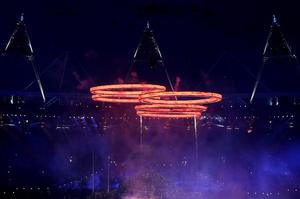 LONDON, ENGLAND - JULY 27:  Rings representing both the Olympics and the Industrial Revolution are lit during the Opening Ceremony of the London 2012 Olympic Games at the Olympic Stadium on July 27, 2012 in London, England.  (Photo by Clive Rose/Getty Images)