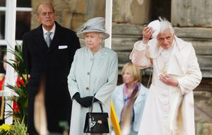 Pope Benedict XVI replaces his zucchetto after the British national anthem is played during his meeting with Queen Elizabeth II and the Duke of Edinburgh at the Palace of Holyroodhouse in Edinburgh on the first day of his four day visit to the United Kingdom
