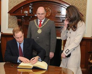 Prince William and Kate Middleton, with The Right Honourable The Lord Mayor of Belfast, Councillor Patrick McConvery (centre), in Belfast City Hall. PRESS ASSOCIATION Photo. Picture date: Tuesday March 8, 2011. See PA story ULSTER Royal. Photo credit should read: Simon Graham/Harrison Photograph/PA Wire