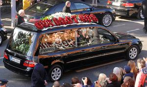 A hearse carries the coffin of Stephen Gately after his funeral at St Laurence O'Toole church in Dublin