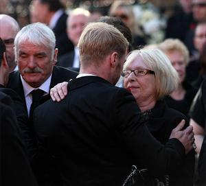 Margaret Gately is comforted by Ronan Keating  outside St Laurence O'Toole Church in Dublin