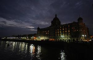The landmark 565-room Taj Mahal hotel is seen after dawn in Mumbai, India, Saturday, Nov. 29, 2008. Indian commandos killed the last remaining gunmen holed up at a luxury Mumbai hotel Saturday, ending a 60-hour rampage through India's financial capital by suspected Islamic militants that killed people and rocked the nation. (AP Photo/Saurabh Das)
