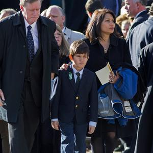 A young mourner leaves the funeral of teacher Anne Marie Murphy, who was killed at the Sandy Hook Elementary School (AP Photo/Craig Ruttle)