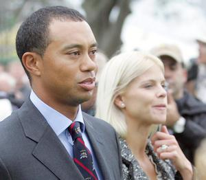 United States Ryder Cup team player Tiger Woods and his wife Elin leave at the end of the opening ceremony for the 2006 Ryder Cup