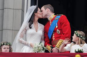 RETRANSMITTED FOR BETTER QUALITY - BEST QUALITY AVAILABLEPrince William and his wife Kate Middleton, who has been given the title of The Duchess of Cambridge, kiss on the balcony of Buckingham Palace, London, following their wedding at Westminster Abbey.  PRESS ASSOCIATION Photo. Picture date: Friday April 29, 2011. See PA story WEDDING Lead. Photo credit should read: John Stillwell/PA Wire