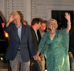 Former US President Bill Clinton and Secretary of State Hillary Clinton attend daughter Chelsea Clinton and her fiance Marc Mezvinsky's pre-wedding party at the Beekman Arms Inn on July 30, 2010