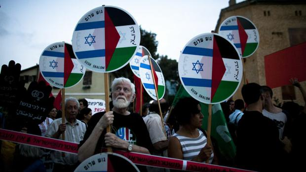 Israeli left-wing protesters demonstrate against Israel's deadly raid on an aid flotilla bound for the blockaded Gaza Strip on May 31, 2010