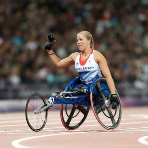 Hannah Cockroft celebrates winning gold in the Women's 100m T34 Final at the Olympic Stadium, London