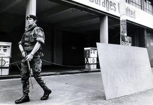 A soldier on guard at the Ulster Garages premises during the U.W.C strike. 1974