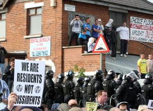 The scene at the Ardoyne interface in north Belfast as an Orange parade passes through the flashpoint area