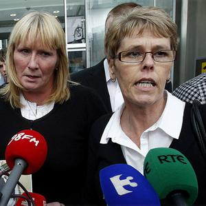 Vivienne Sanderson, right, sister of Raymond Bates, and Brenda Bates his widow, read a statement outside court in Dublin