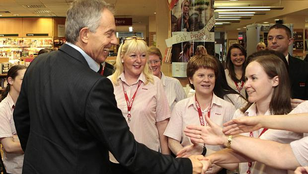 Former Prime Minister Tony Blair, atttending his first book signing, meets staff at Eason's bookstore,  Dublin