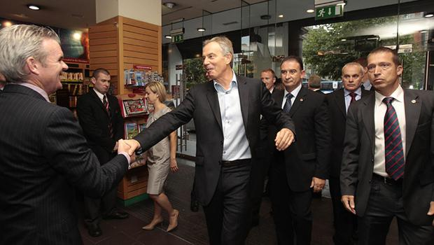 Former Prime Minister Tony Blair, atttending his first book signing, meets Conor Whelen, Managing Director of Eason bookstore,  Dublin