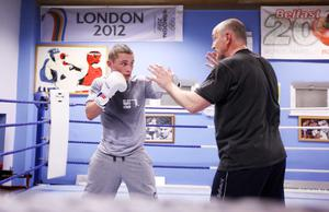 Carl Frampton works out with manager and former champion Barry McGuigan