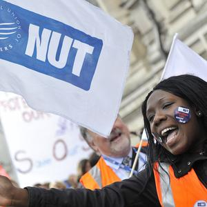 Member of the National Union of Teachers chant slogans during the rally