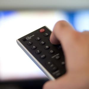 Nearly half of all parents are unhappy with programmes and adverts on TV before the watershed, a survey showed