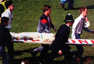 Kevin Williams stretchered off on the Hillsborough pitch during the Hillsborough disaster