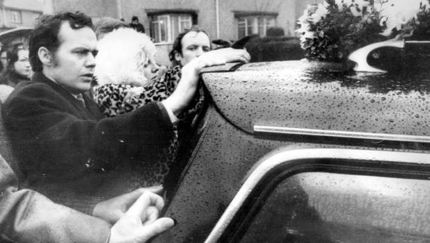 Bloody Sunday. Funeral. Mrs Ita McKinney, 9 months pregnant cries behind the hearse carrying her husband James from St Mary's, Creggan.  2/2/1972.