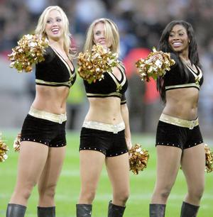 """The New Orleans Saints cheerleaders """"The Saintsations"""" during the NFL match at Wembley Stadium, London."""