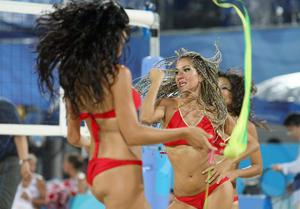 Cheerleaders perform during a time out in the Women's preliminary match of Beach Volleyball at Beijing's Chaoyang Park Beach volleyball ground