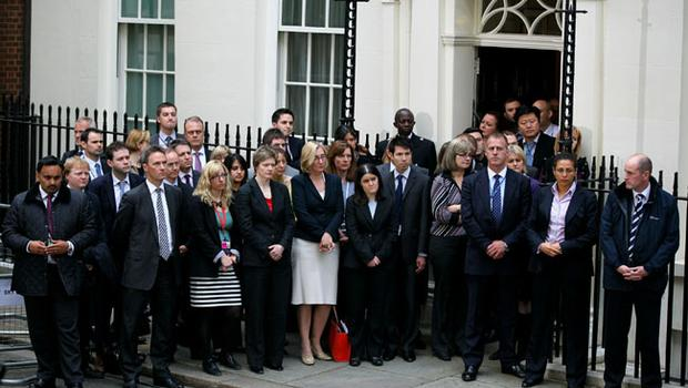 Staff listen to  British Prime Minister Gordon Brown making a statement as he leaves Downing Street on May 11, 2010 in London, England
