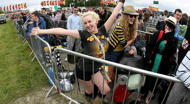 Festival goers Sinead Feeney and Clara Brown, from Derry, arriving at the 09 Oxegen Festival in Punchestown