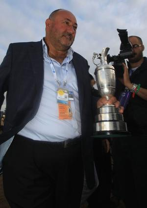 SANDWICH, ENGLAND - JULY 17:  Manager Andrew 'Chubby' Chandler holds the Claret Jug following Darren Clarke's victory at the end of the final round of The 140th Open Championship at Royal St George's on July 17, 2011 in Sandwich, England.  (Photo by Streeter Lecka/Getty Images)