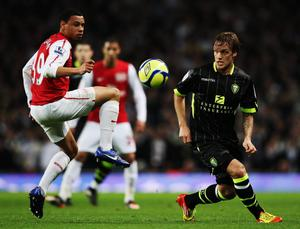 LONDON, ENGLAND - JANUARY 09:  Francis Coquelin (L) of Arsenal and Mika Vayrynen (R) of Leeds United challenge for the ball during the FA Cup Third Round match between Arsenal and Leeds United at the Emirates Stadium on January 9, 2012 in London, England.  (Photo by Clive Mason/Getty Images)