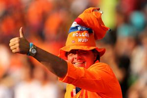 KHARKOV, UKRAINE - JUNE 09:  Dutch fans soak up the atmopshere prior to the UEFA EURO 2012 group B match between Netherlands and Denmark at Metalist Stadium on June 9, 2012 in Kharkov, Ukraine.  (Photo by Ian Walton/Getty Images)