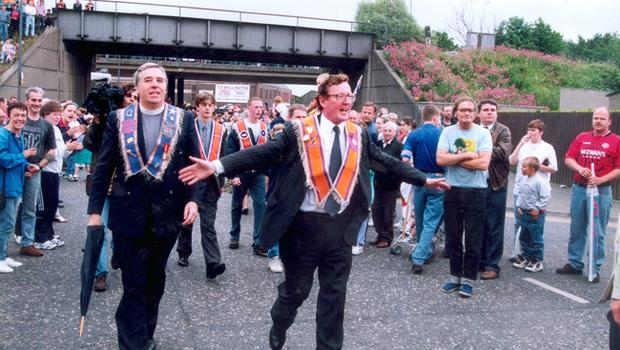 DAVID TRIMBLE MAKES HIS WAY TO GREET THE PORTADOWN ORANGEMEN AFTER THEY MARCHED DOWN GARVAGHY RD 1996.