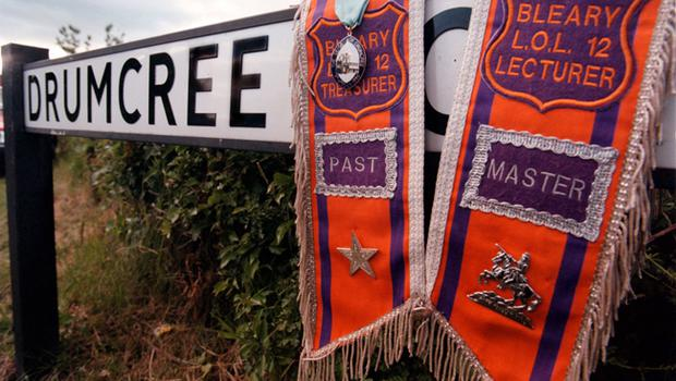 Drumcree Orange Order Demonstration Scarfs drapped around the Road Sign of Drumcree near Portadown
