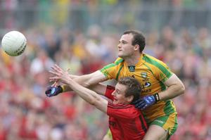 Donegal's Neil McGee with Eoin McCartan of Down
